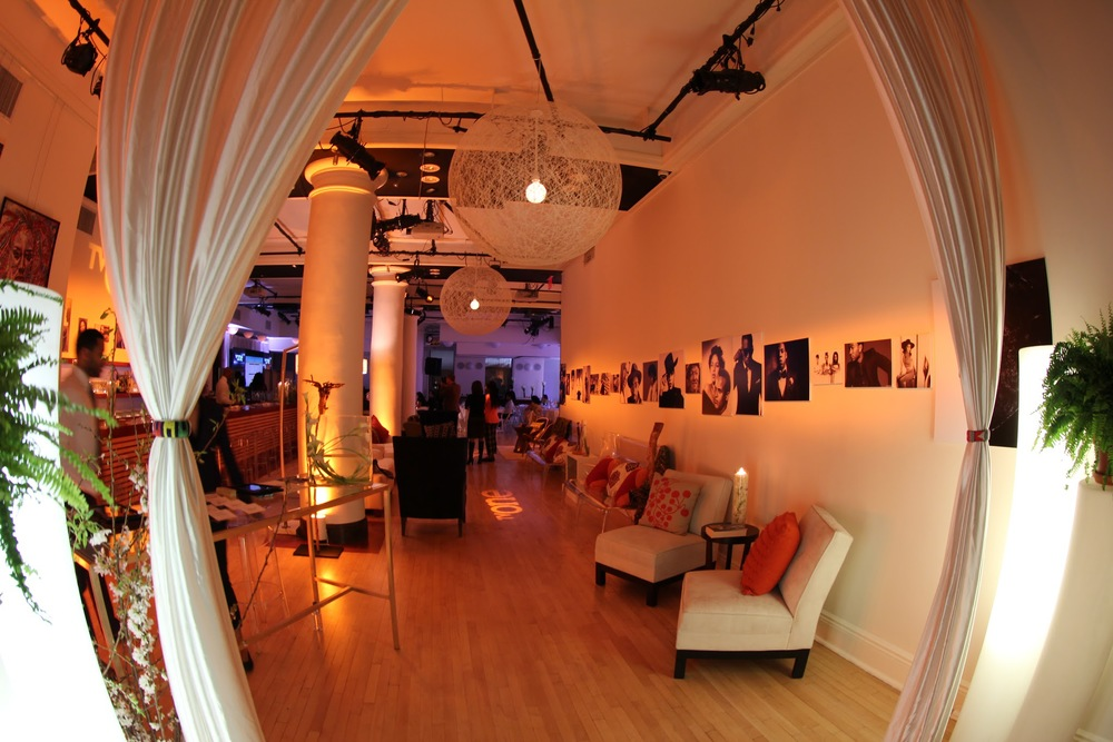 The Entryway, the space exuded luxury and comfort. Images of icons flanked each of the walls. The TV One team made great use of the venue's gallery molding to hang lighting and set up gobo projections.