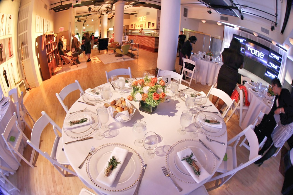 Seating for VIP Lunches Guests were treated to intimate meals for some of the presentations. The tables were set with gorgeous flower centerpieces, delicate chargers, and crisp white linens.