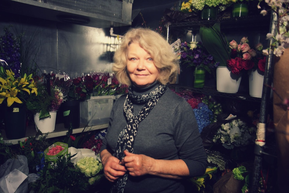 Merriel Weston, founder of Merriel Weston Floral Design, poses in the walk-in plant refrigerator.