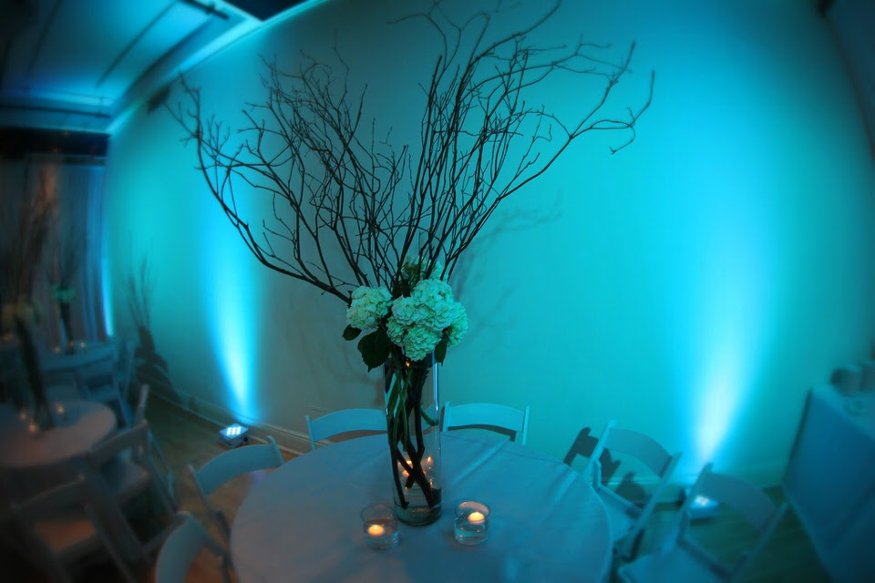 Sophia's Bat Mitzvah at HELEN MILLS - Tables with gorgeous centerpieces across from the bar.  Hydrangea and branges complement the venue's high ceilings.
