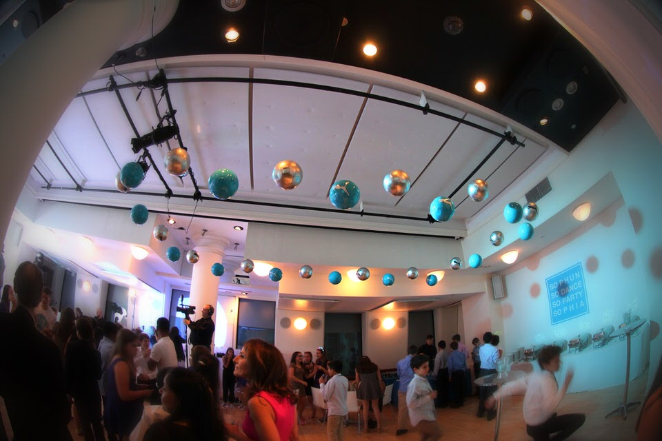 Sophia's Bat Mitzvah at HELEN MILLS - Creative decor included soccer balls suspended from the ceiling.