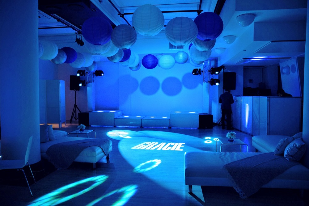 The dance floor featured paper lanterns, gobos, and LED - raised platform, lounge ottomans, and more. Photo by Art Photographers.