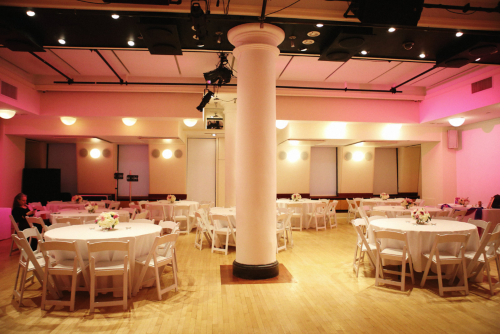 The HELEN MILLS Event Space ready for arrivals!  The hot pink wall wash and floral centerpieces set the tone.