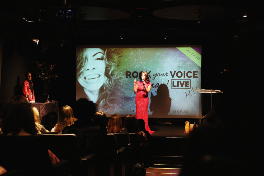CEO & Founder of Rock It Out Woman, Christine Miskinis, takes the stage for a powerful presentation.