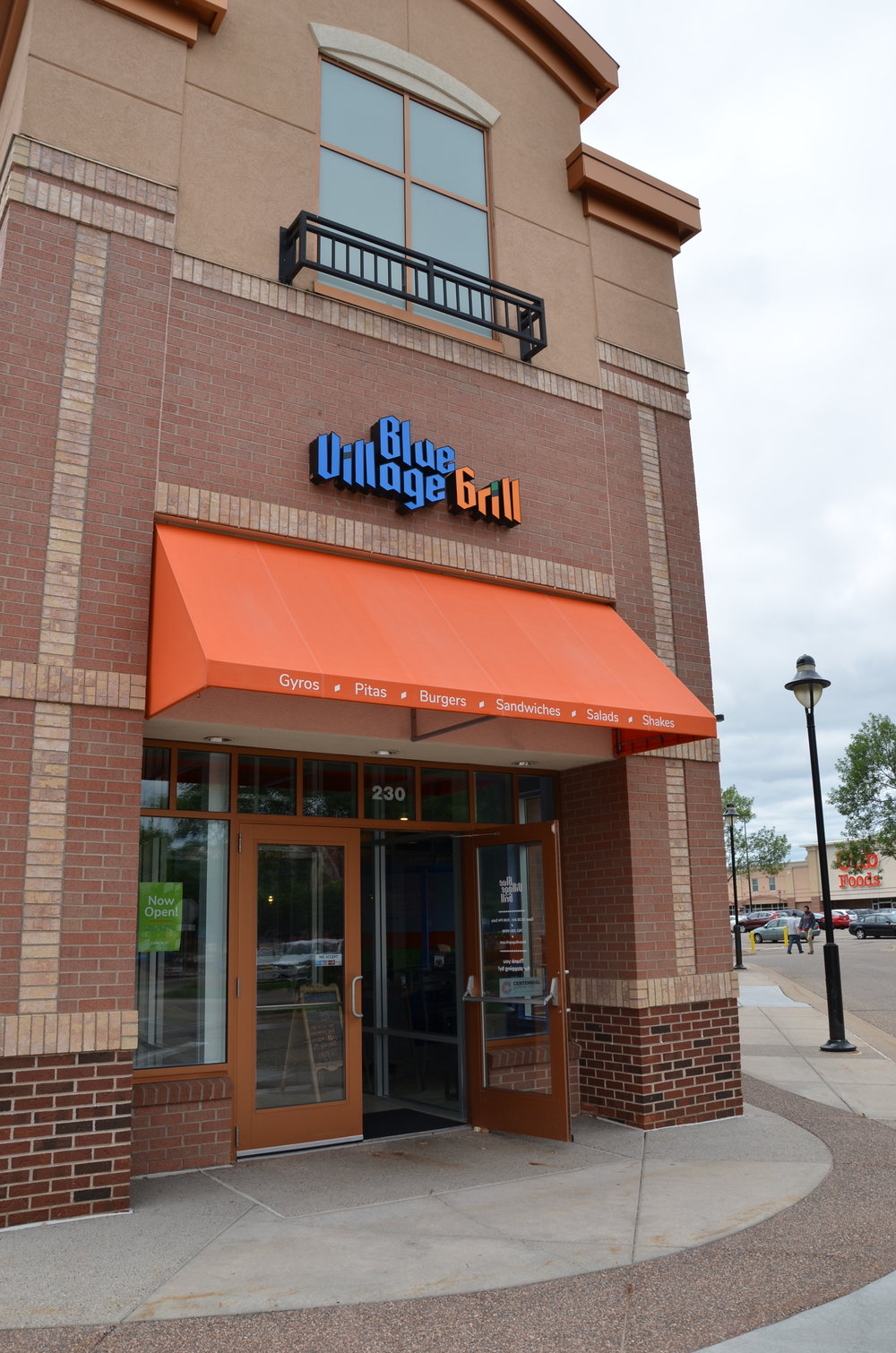 Blue Village Grill is located in the  Village of Blaine  shopping center, off 35W and Lexington Ave.