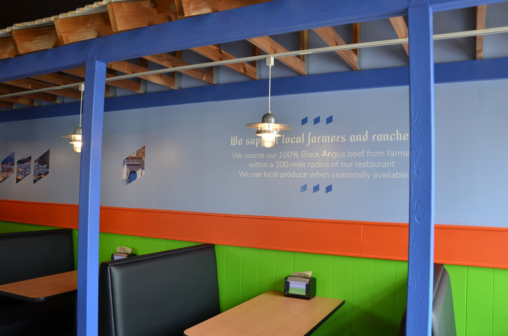 Messaging, images, and colors that reinforce the brand are integrated into the restaurant's interior design.