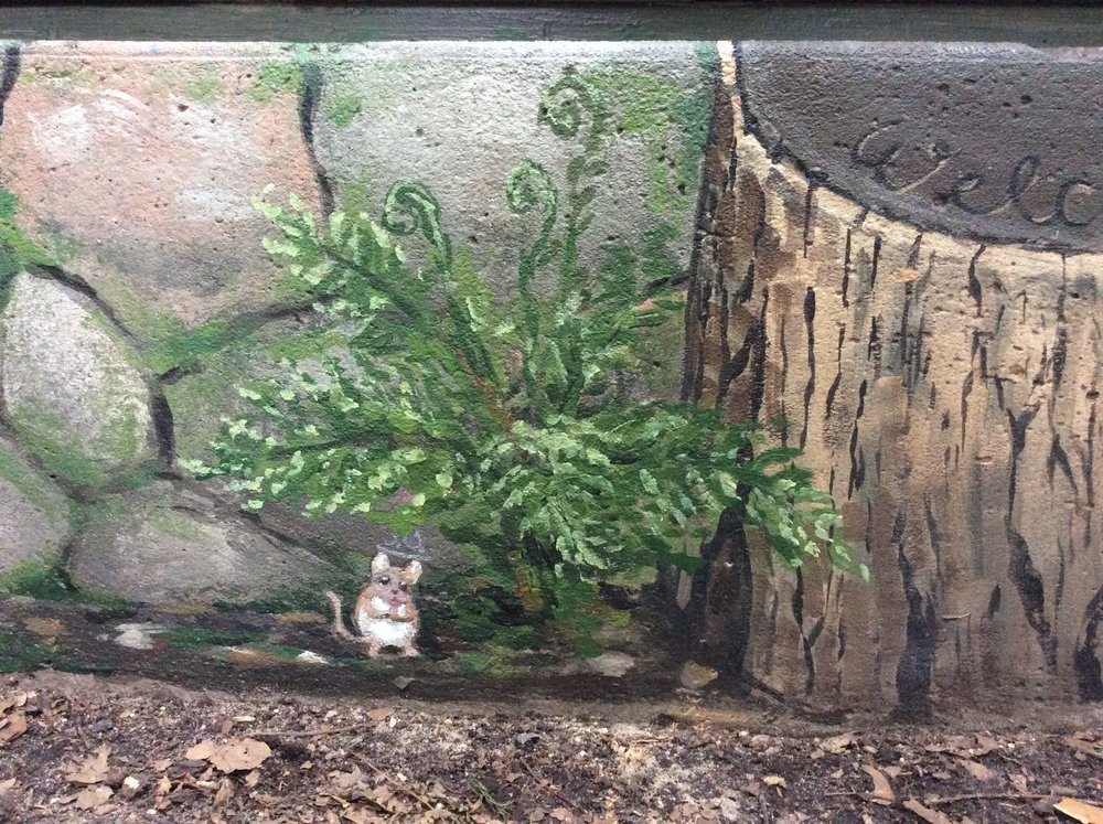 Here a little mouse pauses under a fern before it scurries back into his hole in the stump. My daughter painted the little mouse.