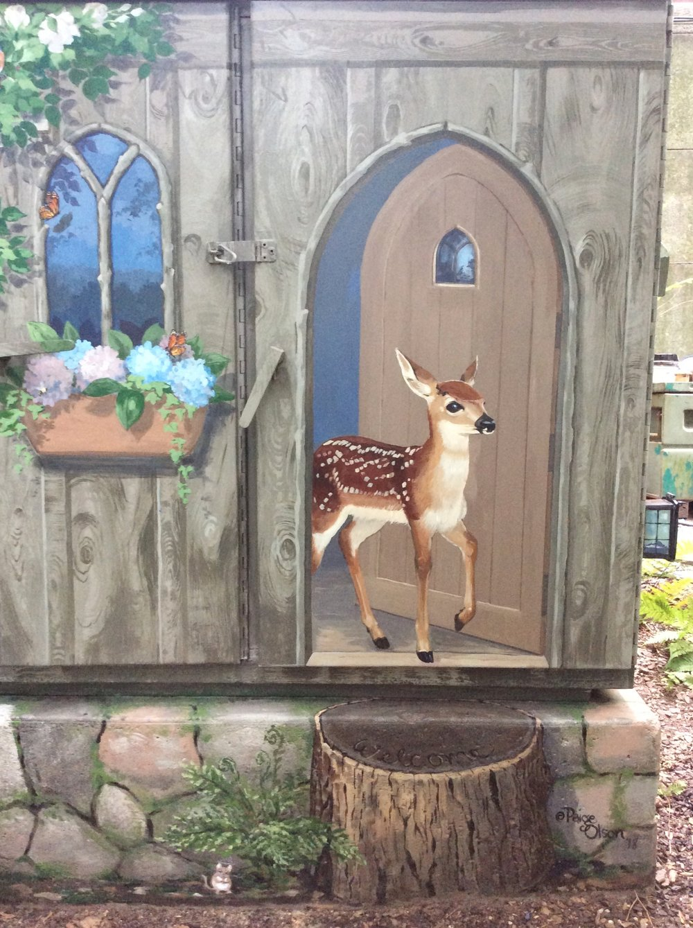The fawn emerges from an empty cottage.