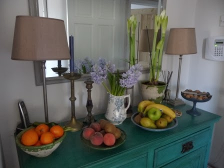On my Annie Sloan painted mahogany sideboard in the kitchen is a vintage jug with beautiful blue/mauve hyacinths and a white Amaryllis which has the first of three flowers about to burst open.