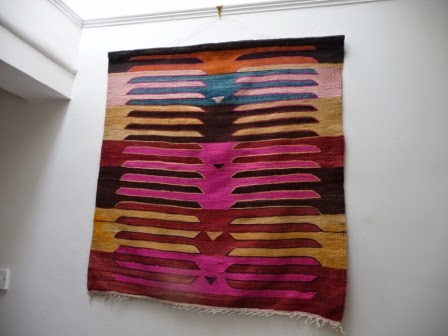 Hanging a Turkish rug in vibrant colours