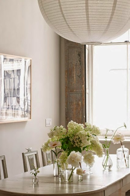 A monotone white display of frothy blooms in clear glass creates an elegant look.