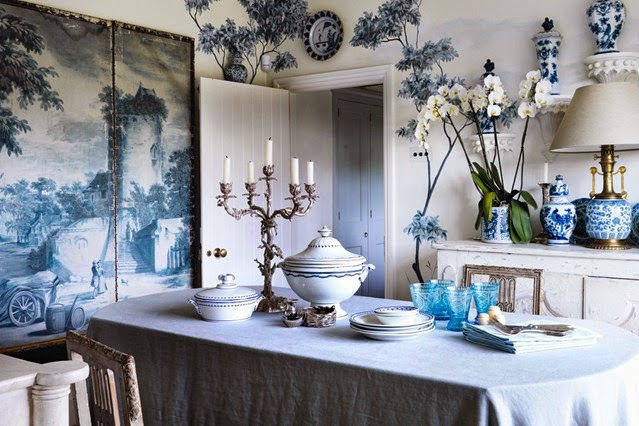 I love the simplicity of the orchid plant complementing this blue and white room.