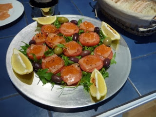 Two starters - slices of tomato and smoked salmon: