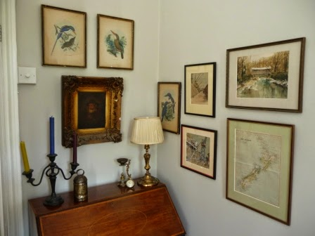 Disparate artwork grouping in my sitting room.
