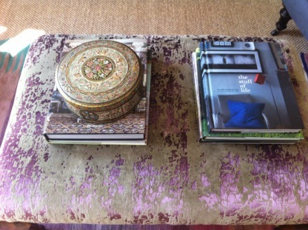 Here I have placed a vintage biscuit tin on top of the books.