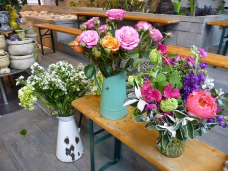 Some of the vases of flowers on the stand.  Love the roses