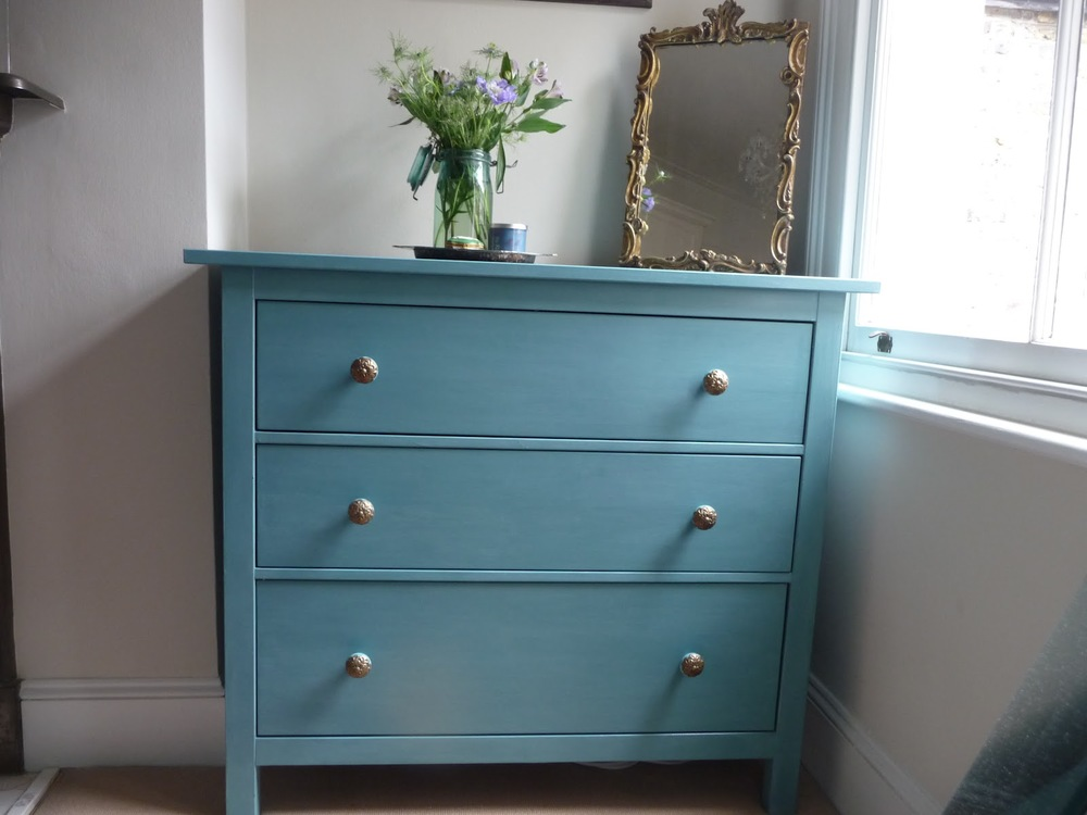 Ikea chest of drawers painted in Provence and inside of drawers painted 'Greek Blue'. Handles are from Anthropologie.