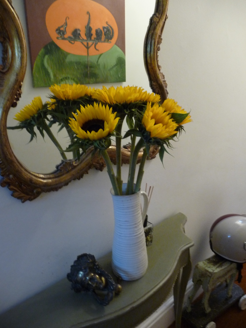 Good old Sunflowers, cheap as chips and last forever. Remove the leaves as they take too much sustenance from the flower. Cut vertically up the stems as well as the usual diagonal.  Beware the drink loads so you need to top up regularly