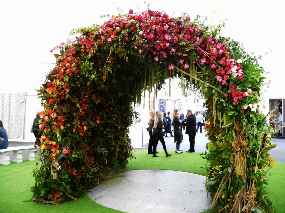 Beautiful archway of flowers in the foyer at Decorex