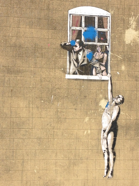 The most famous Banksy in Bristol unfortunately attacked with blue paint by vandals