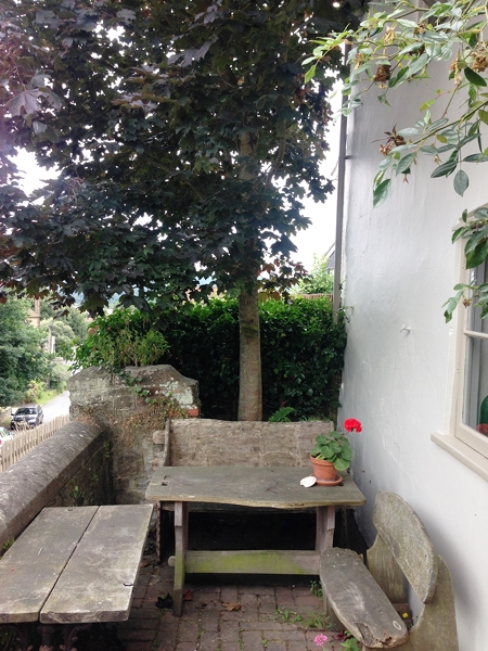 There are many intimate areas to sit which are quirky but beautiful. This tiny seating area is the only one at the front of the pub looking across the road to the church