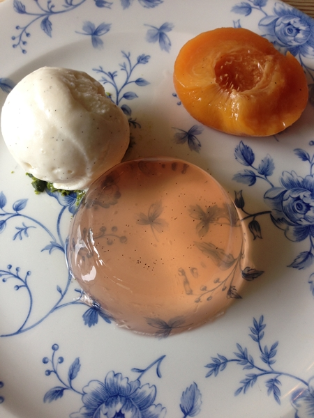 Dessert of peach jelly, poached peaches and vanilla ice-cream