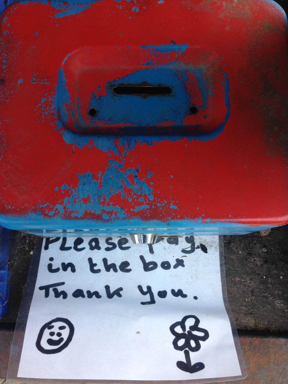 An honesty box for the fruit & veg for sale