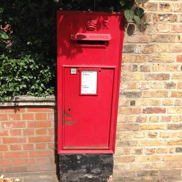 A post box built into the brick wall of one of the houses
