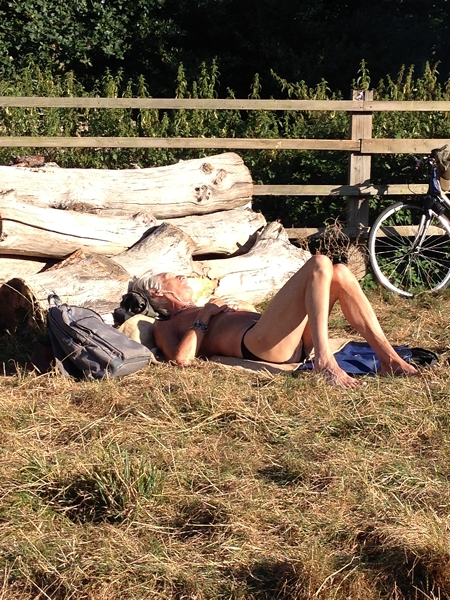 This cyclist had stripped off in the meadow to catch the rays!!