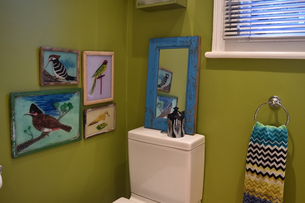 I've hung the four Indian bird paintings (painted on glass) at right angles to the turquoise framed Indian mirror.