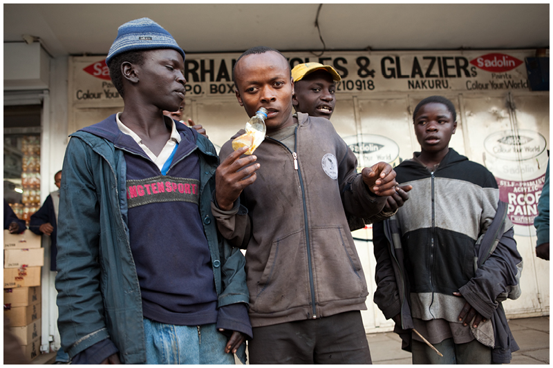Some of the local street boys in the streets of Nakuru. It is common to see them inhaling from bottles like these filled with glue.