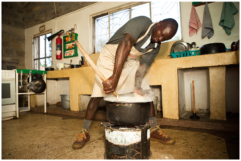 There are always hungry mouths to feed around here! Eric stirs the maize meal porridge over the coal fire, making sure it reaches the perfect consistency.