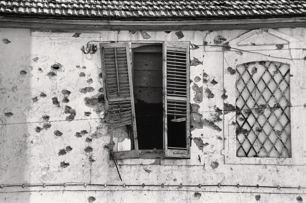 bullet-holes-in-a-facade-cyprus-1974-web (1).jpg