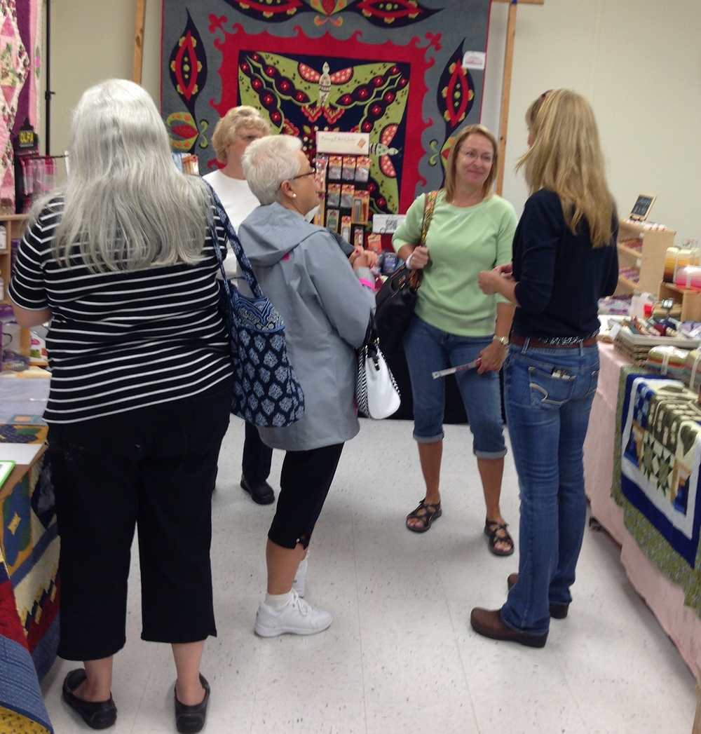 Nancy Ellen Quilts vending at a quilt show on Long Island