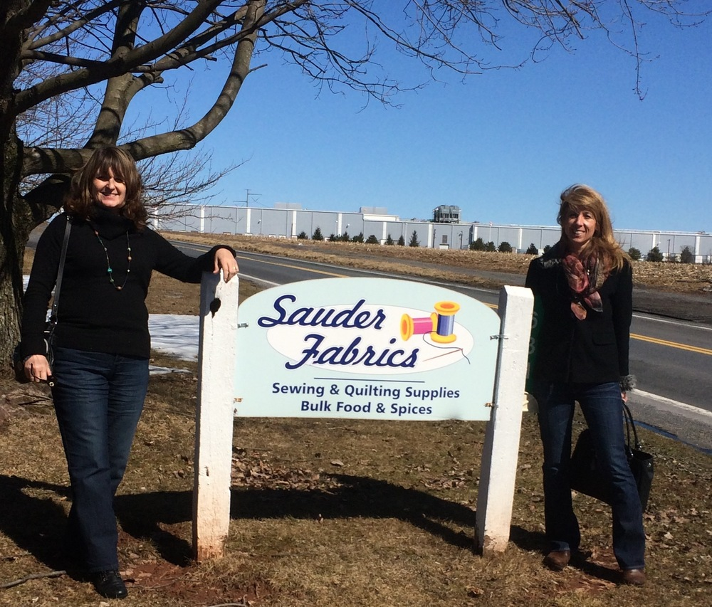 Sauders Fabrics ( somewhere near Lancaster)-Karen (left) and Me (right).  It was such a windy day as we just arrived.