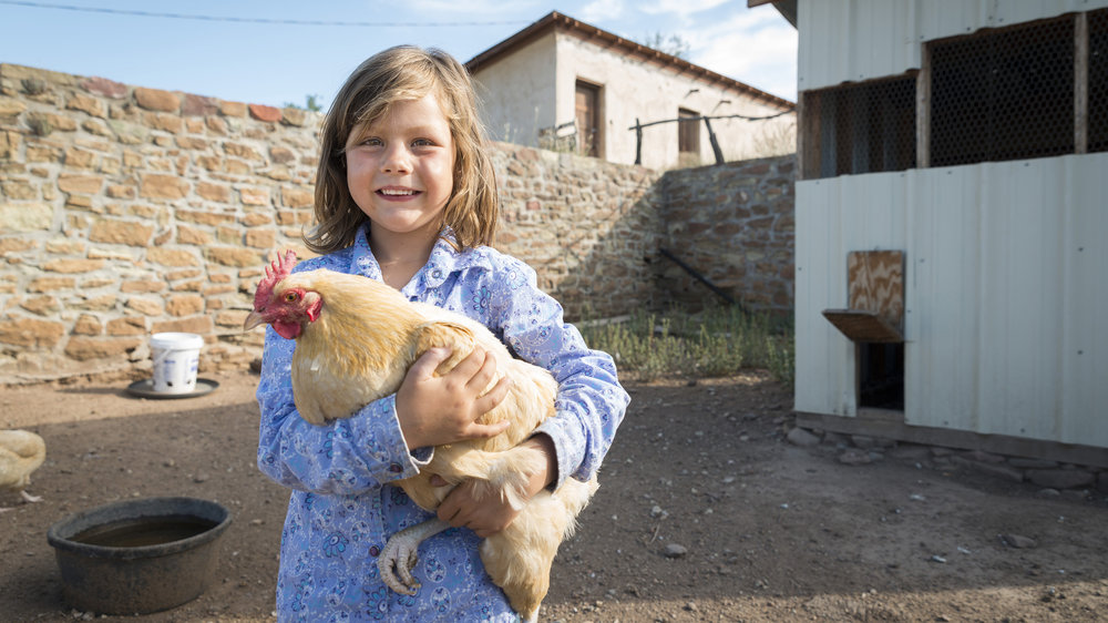 Mackenzie Lewis with Chicken, Cathedral Mountain Ranch, Texas