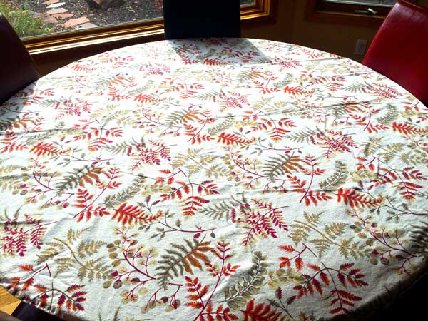 A festive tablecloth.  You can opt to iron this or fluff it in the dryer but a lot of times the wrinkles just seem to flatten out as the day goes on.  People still appreciate a nice table even with a few wrinkles! Don't sweat the small stuff. This is supposed to be fun.