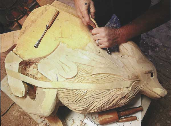Scott carving a coyote.  This piece took him over 4 months, just to give you an idea of the time frame. (Photo Courtesy of the Carousel of Happiness, James DeWalt, Tom Walker, and Kay Turnbaugh.)