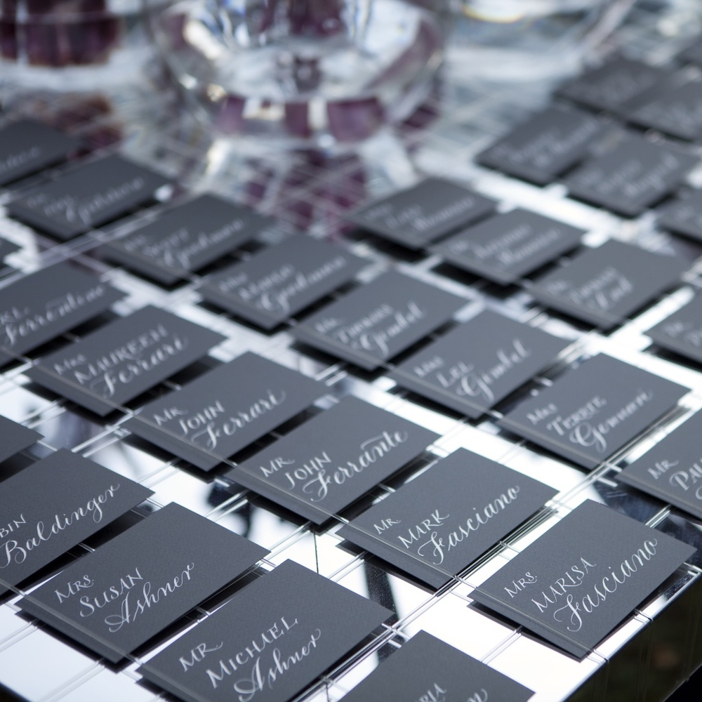 Escort cards in their envelopes ready for guests.