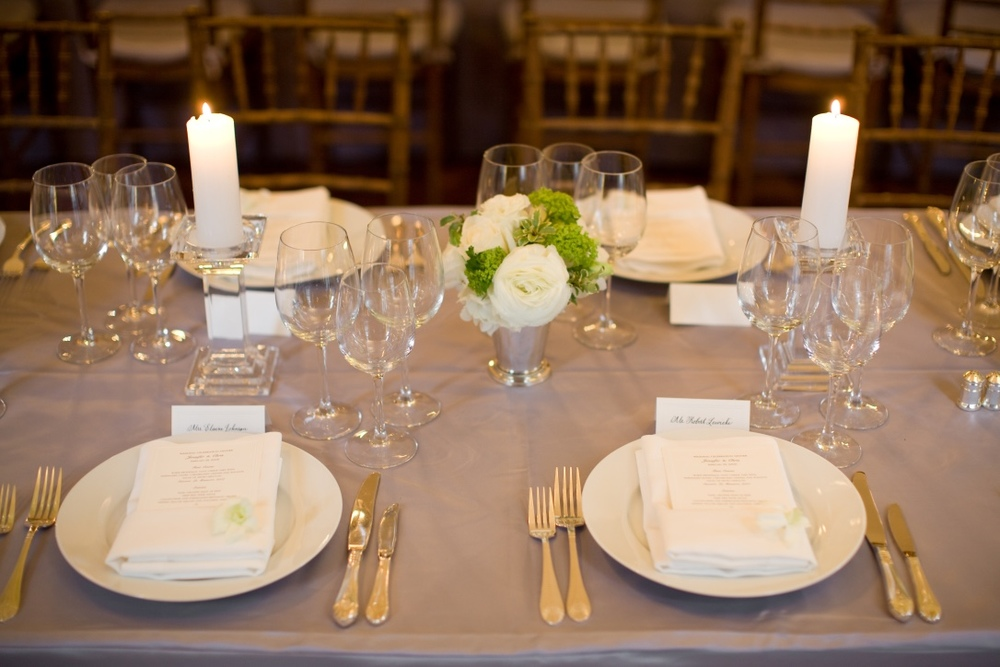 Two place settings with their respective place cards.