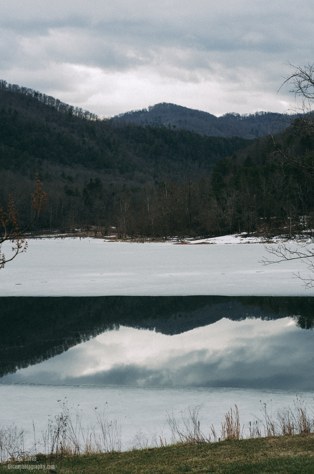 "Unrelated, but a somewhat ""trippy"" photo of Watauga Lake, in Tennessee. Reflections on ice - You don't see them too often in Florida."