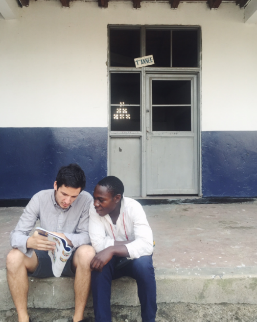Jonathan going over an ESL book with one of our  Freedom   Boys