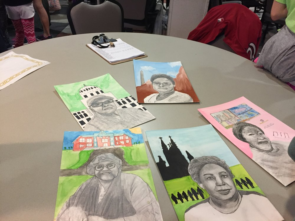 Some of the beautiful portraits our students created (and delivered) to SOME seniors!