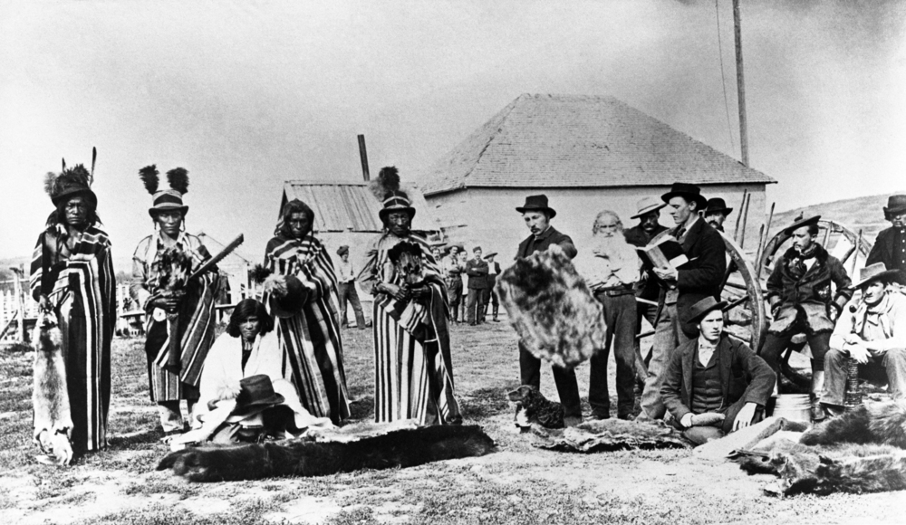 Group of Cree men at Fort Pitt, Saskatchewan, 1884. Image: NA-382-1 courtesy of Glenbow Archives.  Questions this image raises: How do we tell these people's stories in documentary form with care, detail and critical distance? Who would each one identify with in The Breakfast Club? Does anyone ever identify with the principal? Note: Mean Girls in the background.