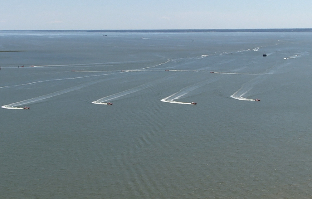 Unmanned Naval watercraft operating under swarm intelligence programming.  Image Credit: DefenseTech.org