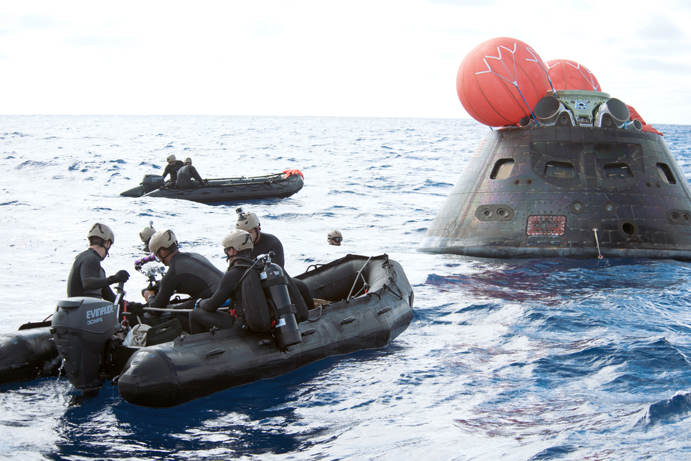 The Orion space capsule being recovered after its inaugural flight in December 5, 2014.  Image Credit: NASA