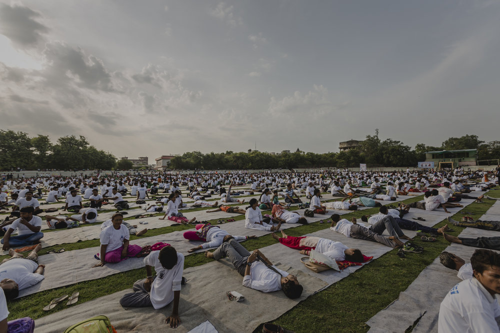 Partaking in the International Yoga Day held for hundreds at Varanasi Stadium.
