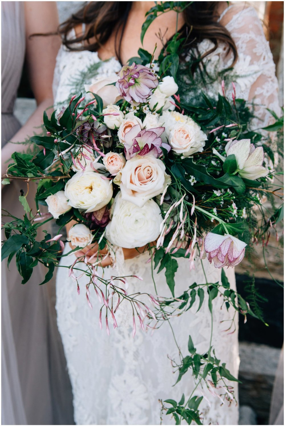 I used wild cascading jasmine, hellebores both white and tinged purple, plumosa, ferns, ranunculus, and sweet smelling and spiraling garden roses which were the perfect compliment to her vintage and pure romance vibes.