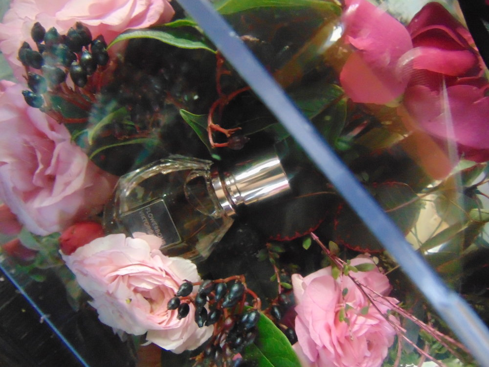 box of flowers and parfume