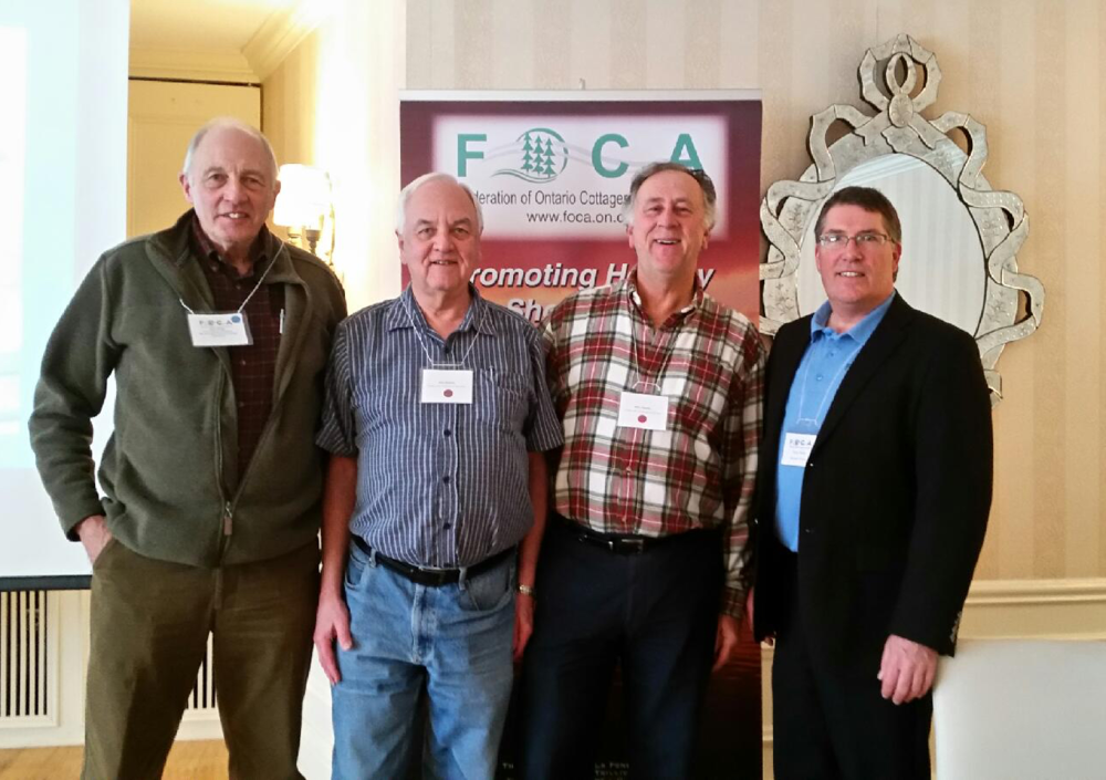 From left to right: Federation of Ontario Cottage Association (FOCA) President Ken Grant, PLCA Treasurer Allan McKellar, PLCA President Mike Thomas, and FOCA Executive Director Terry Rees, at the March 5thFOCA AGM in Toronto.